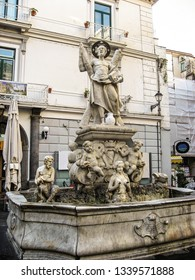 """AMALFI, ITALY-OCT. 7, 2008-Fountain of St. Andrew in the central square of Amalfi with the translation from the Latin, """"This is a permanent consecrated source"""""""