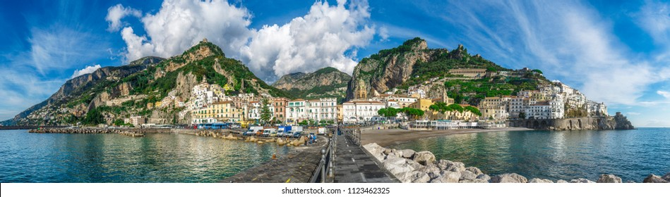 Amalfi (Salerno, Campania), Italy -  13 June 2018: Beautiful panorama of Amalfi, the main town of the coast on which it is located taken from the sea. Near Positano. Panoramic view with turquoise sea