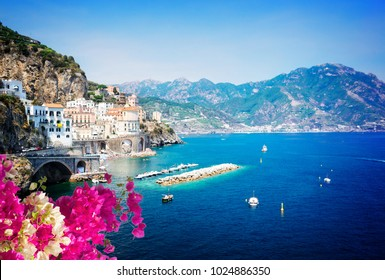 Amalfi summer coast and Tyrrhenian sea with boats and with flowers, Italy
