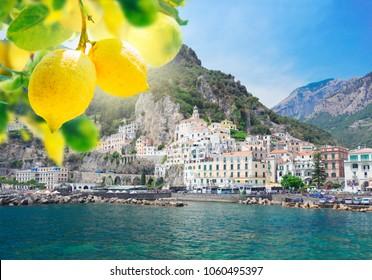 Amalfi town embankment and Tyrrhenian sea waters with lemons, Italy