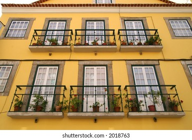 Amalia Rodrigues yellow painted house front in Lisbon