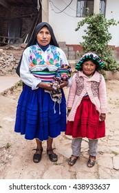 AMANTANI, PERU - MAY 15, 2015: Members of a native family living on Amantani island in Titicaca lake, Peru