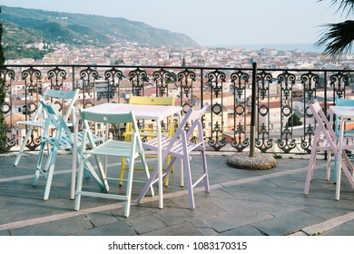 Amantea, Calabria Italy - Panorama of Amantea from a terrace with colorful chairs and tables