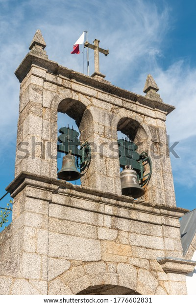 AMARANTE, PORTUGAL - CIRCA JULY 2020: Bells tower on Church of Gatao. The Church of Gatão is a building whose construction timeline extends through the 13th and 14th centuries.