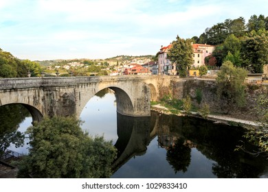 AMARANTE, PORTUGAL - September 23, 2017: View of the Tamega River and the eighteenth century bridge in baroque and neoclassic styles, in Amarante, Portugal