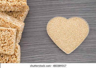 Amaranth bars in the wooden background