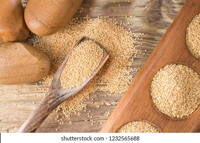 amaranth beans in bowl, on rustic wooden background
