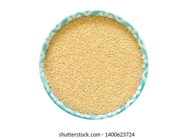 Amaranth grain in ceramic bowl isolated on a white background.Top view.