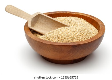 Amaranth grains in wooden bowl with scoop isolated on white background