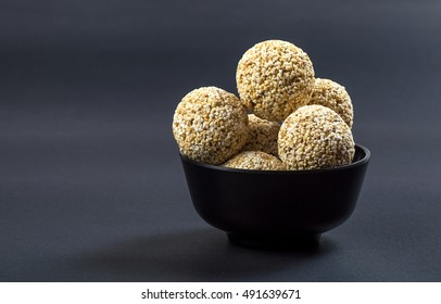 Amaranth or Rajgira laddu, Cholai ke laddo in black Bowl on black background