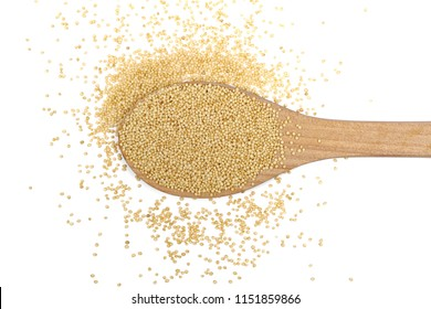 Amaranth seeds in wooden spoon isolated on white background, top view