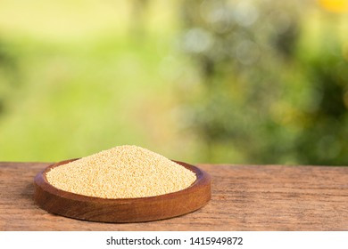 Amaranthus - Organic amaranth seeds. Wooden table in the park among the trees on a summer day.