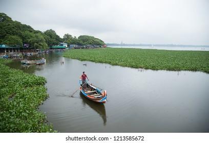 AMARAPURA, MYANMAR - Oct. 15 2018: fishman  in a lake in Amarapura, Myanmar. Amarapura is famed for the longest teak bridge in the world.