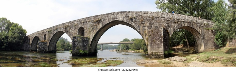 Amares, Portugal - July 18, 2021: Bridge of Prozelo, aka the Porto Bridge, built in 14th century over the Cavado River, in Amares not far from Braga, panoramic shot