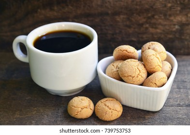 Amaretti cookies.Typical Italian almond amarettini biscuits and cup of coffee.