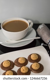 Amaretti Italian cookies and cup coffee. Vertical. Free space