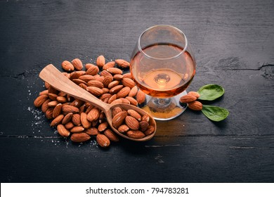 Amaretto Almond Liquor. Almond On a wooden background. Italian drink Top view. Free space for text.