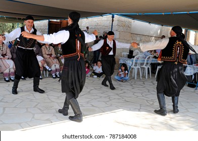 AMARGETI, PAPHOS, CYPRUS, OCTOBER 2016. Traditional Greek/Cypriot dancers at the annual village Festival in Amargeti a small traditional Cypriot farming village in the hills above Paphos. Male Dancers
