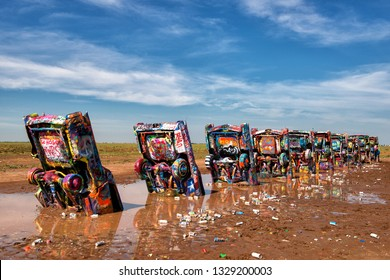 Amarillo, Texas - 04.07.2015: The Cadillac Ranch. Famous sculpture of half-buried Cadillac-cars that was created in 1974 by Chip Lord, Hudson Marquez and Doug Michels.
