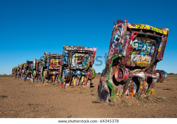 AMARILLO, TEXAS - OCTOBER 27: Famous art installation of the old Cadillac cars on on October 27, 2010 at Cadillac Ranch near Amarillo, Texas. Often attributed as a popular landmark of Route 66