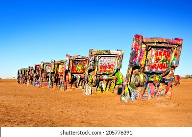 AMARILLO, TEXAS, USA - DEC. 2013: Cadillac Ranch is a public art installation and sculpture in Texas, U.S. created in 1974 by Chip Lord, Hudson Marquez and Doug Michels, of the art group Ant Farm.