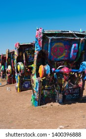 Amarillo, TX - August 23, 2015: Someone has painted a peace sign on the underside of a car at the popular public art installation known as Cadillac Ranch.
