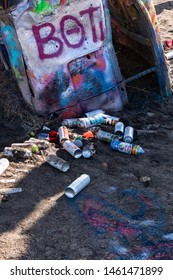 Amarillo, TX/USA 03/24/2019   This group of Krylon spray paint cans was found at the famous Cadillac Ranch tourist site. Visitors leave their used cans on the ground, instead of in a trash bin.