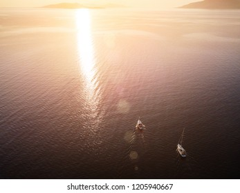 Amasing aerial view to two Yachts in deep blue sea on sunset. Drone photography