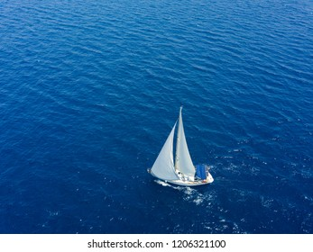 Amasing aerial view to two Yachts in deep blue sea. Drone photography