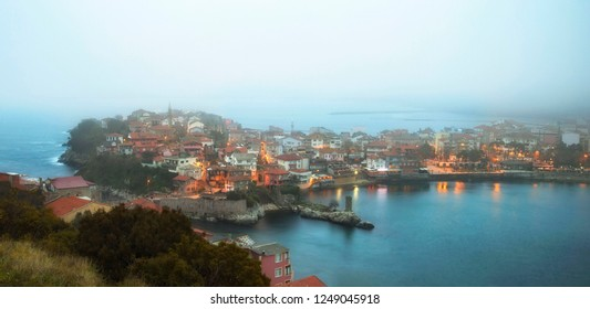 Amasra, Bartin - Turkey, Amasra is a small tourist historical unique town in the West black sea region of Turkey. Gloomy foggy cityscape at sunset.