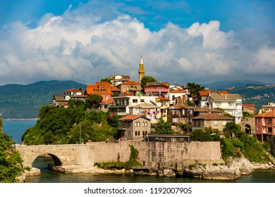 Amasra  in the north of Turkey. There are a lot of old houses belong to turkish architecture. Cloudy sky above the city.