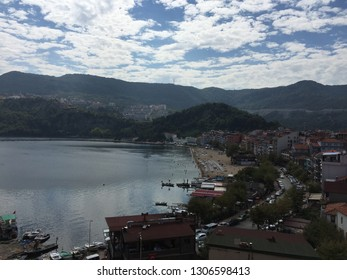 Amasra town center includes buildings, streets, bay, beach, green hills, small boats, sandals...(092015-Amasra, Turkey)