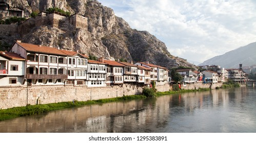 Amasya / Turkey - 09/29/2015: Amasya, Turkey - February 11, 2017 : Old Ottoman houses view by the Yesilirmak River. Amasya, Turkey.