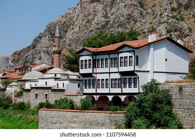 Amasya, Turkey - 7 June 2018: Old Ottoman houses panoramic view by the Yesilirmak River in Amasya City. Amasya is populer tourist destination in Turkey.
