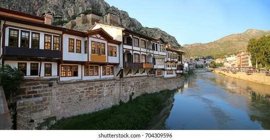 Amasya, Turkey - August, 2017: Old Ottoman houses panoramic view by the Yesilirmak River in Amasya. Amasya is a city in northern Turkey and is the capital of Amasya Province, in the Black Sea Region.