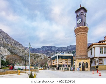 Amasya, Turkey - February 11, 2017 : Old Ottoman houses and clock tower view by the Yesilirmak River in Amasya City. Amasya is populer tourist destination in Turkey.