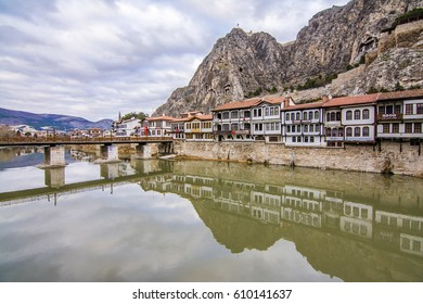 Amasya, Turkey - February 12, 2017 : Old Ottoman houses evening panoramic view by the Yesilirmak River in Amasya City. Amasya is populer tourist destination in Turkey.