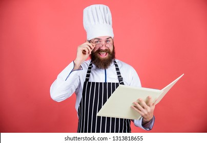 Amateur cook read book recipes. Culinary arts concept. Man learn recipe. Try something new. Cookery on my mind. Improve cooking skill. Book recipes. According to recipe. Man bearded chef cooking food.