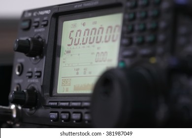 Amateur radio station: closeup of an a radio transceiver,focus frequency  light