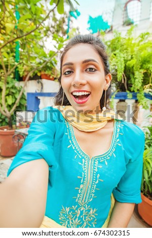 Amateur Style Selfie Photograph Of A Cheerful Indian Woman