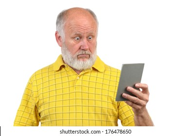 amazed and astonished senior bald man looking into mirror