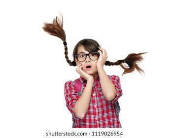 Amazed brunette school girl with flying hair isolated on white