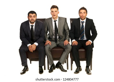 Amazed business men sitting on chairs isolated on white background