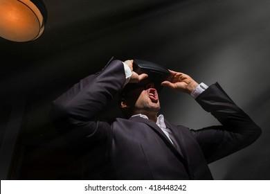 amazed businessman playing a virtual reality simulation