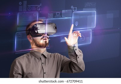 Amazed businessman with virtual reality charts and data in front of him