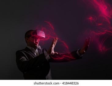 amazed businessman wearing virtual reality glasses . Futuristic overlay design