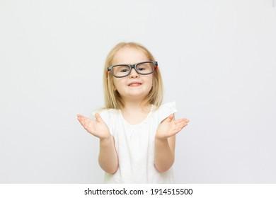 Amazed girl closeup portrait in glasses