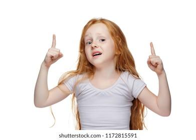Amazed girl pointing up to white background