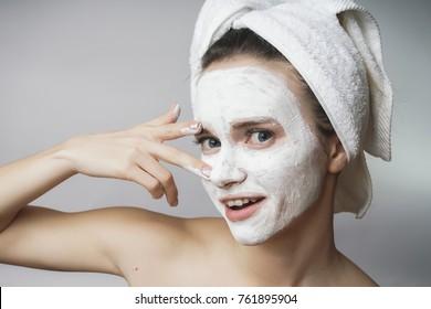 Amazed happy Woman use white cleanser mack, scrub on face