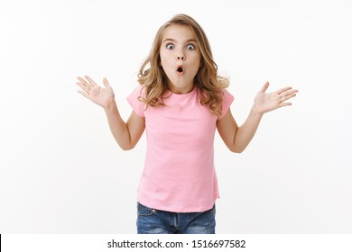 Amazed overwhelmed young kid cute blond girl explain parents incredible news, gesturing raise hands full disbelief amazement and excitement, pouting fold lips astonished say wow awesome